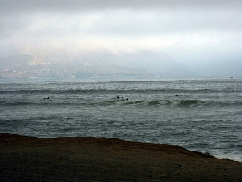 Surfers at Lima's beach