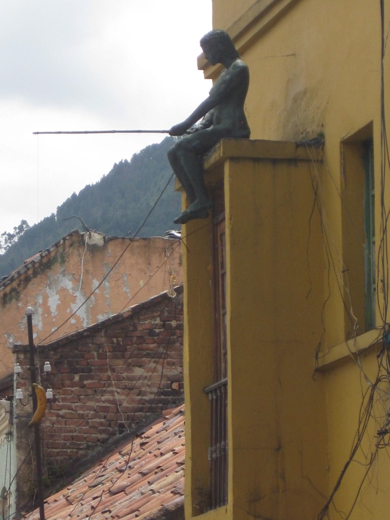 Statue of a person fishing with a banana