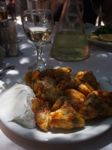 Typical taverna lunch-- zucchini blossoms stuffed with rice, tomatoes and other deliciousness and a carafe of the house white